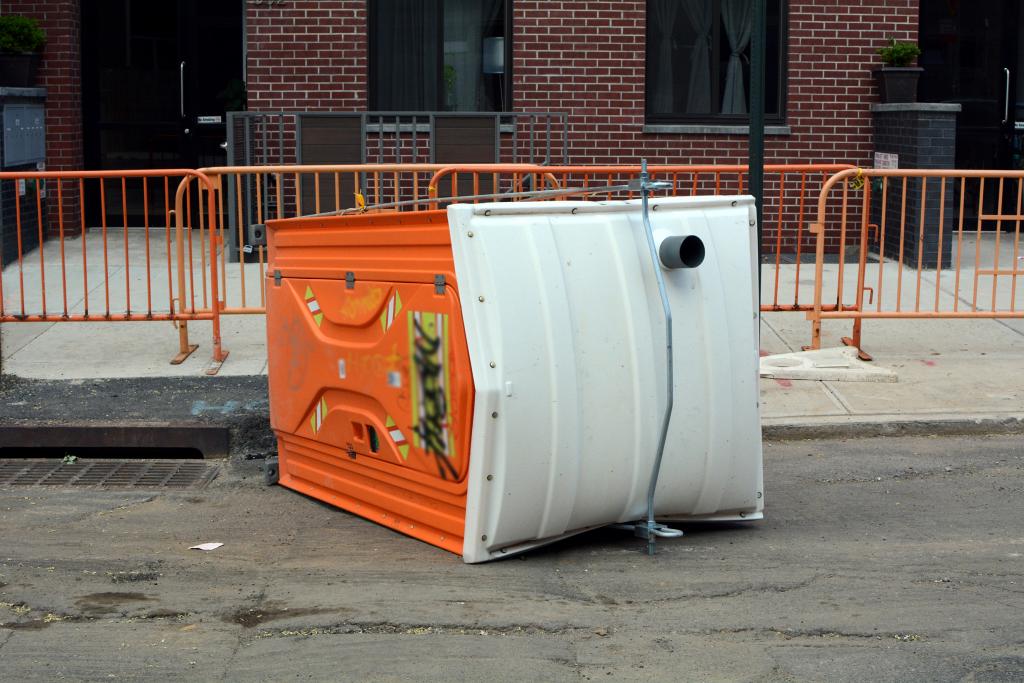 A flipped porta potty