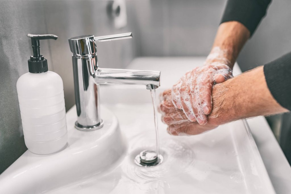 Man Washing Hands To Be Healthy