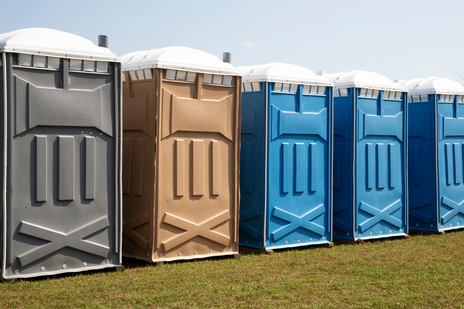 Row Of Colorful Porta Potty Rentals In Dallas Texas